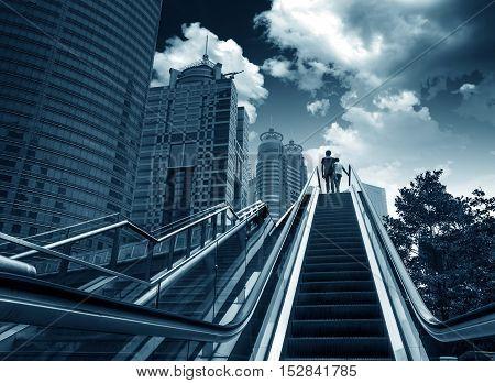 Escalators next to skyscrapers in Shanghai, China.