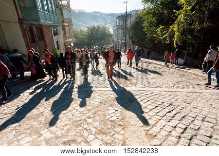TBILISI, GEORGIA - OCT 16, 2016: Shadows on cobbled stones from rushing people during city festival Tbilisoba on October 16, 2016. Tbilisi has a population of 1.5 million people