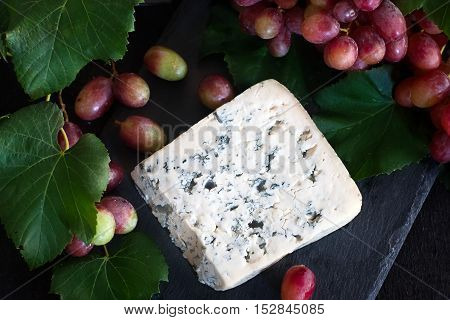 Blue Cheese With Grape Background