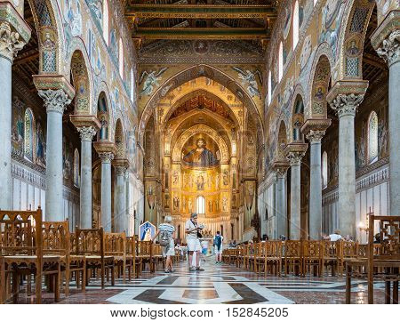 MONREALE ITALY - SEPTEMBER 8 2015: Interior of the Cathedral of Montreale or Duomo di Monreale near Palermo Sicily Italy. It is known for its mosaics on the theme of the Old and the New Testament
