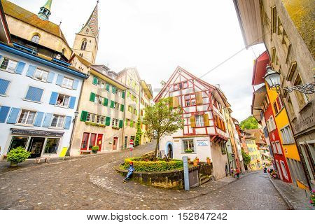 Baden, Switzerland - June 30, 2016: Street view in the center of the old town with Half-timbered house and church tower in Baden, Switzerland
