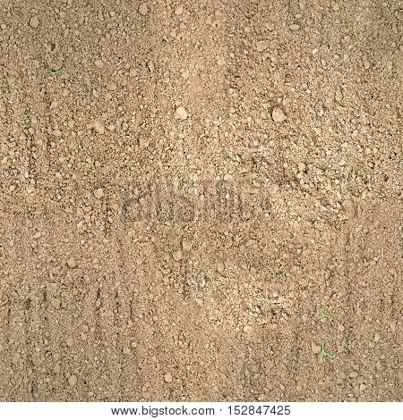 Seamless texture of brown fluffy fresh plowed land.