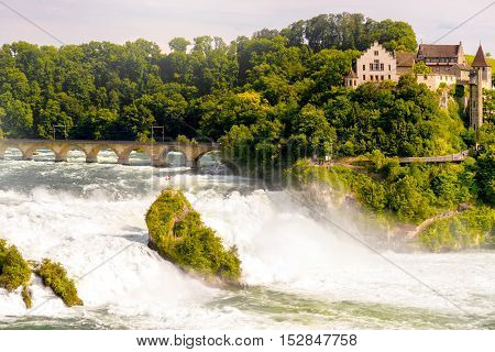 Landscape view on the famous Rhein waterfall near Schaffhausen city on the north of Switzerland. This waterfall is the largest one in Europe