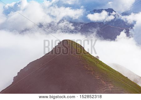 Top of the mountain above the clouds. Caucasus. Russia.