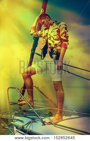 Stylish trendy man on a regatta or yacht