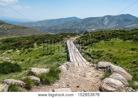 Small wooden bridge in the mountain a sunny day