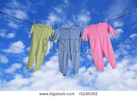 Baby sleepers hanging on the clothesline.