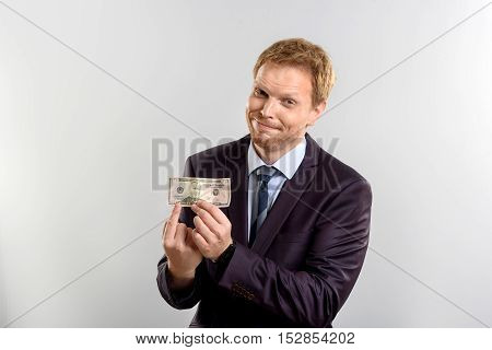 business person with money bill standing and smiling in front of the camera