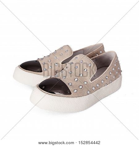 Pair of beige female shoes isolated on white background