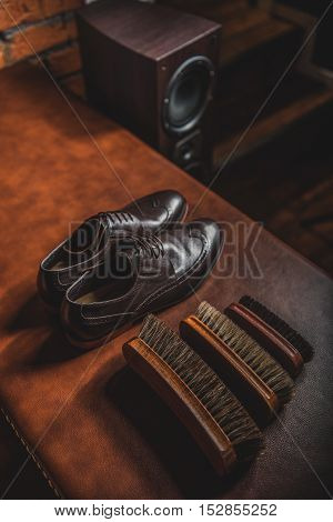 elegant brogues on the table with accessories for shoe shining, close up