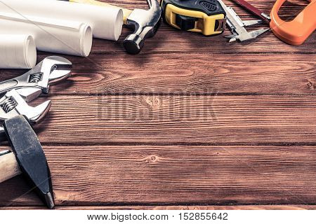 Variety of repair tools on wooden surface and place for text