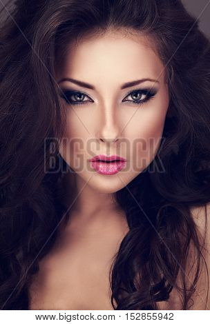 Beautiful Woman With Bright Smokey Makeup Eyes And Pink Lipstick Looking Sexy. Closeup Toned Portrai