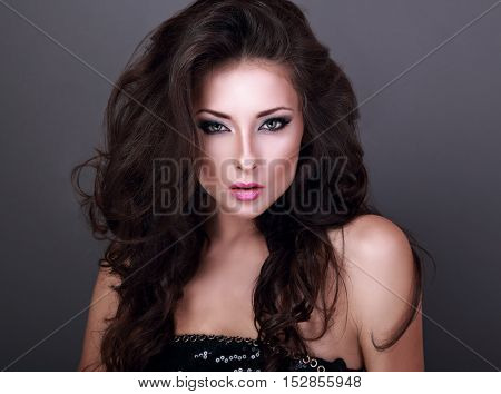 Beautiful Woman With Bright Smokey Makeup Eyes And Pink Lipstick Looking Sexy. Volume Curly Hair Sty