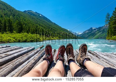 Backpackers Rest In Green Highlands Of Altai Mountains, Russia