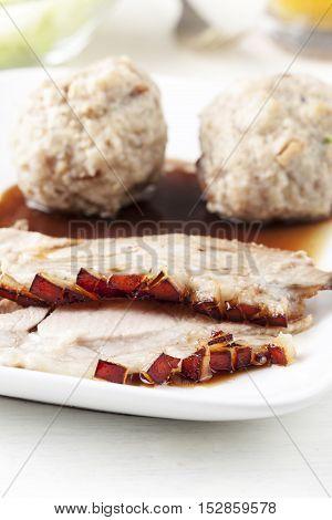 closeup of a bavarian roasted pork on a plate