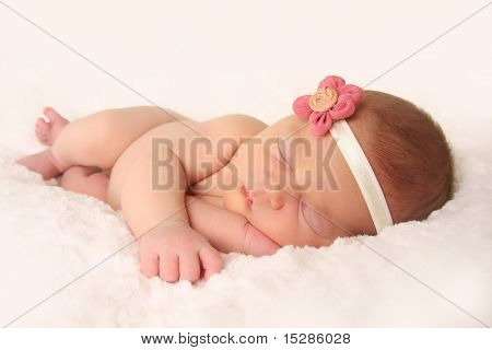 Newborn baby girl, sleeping.