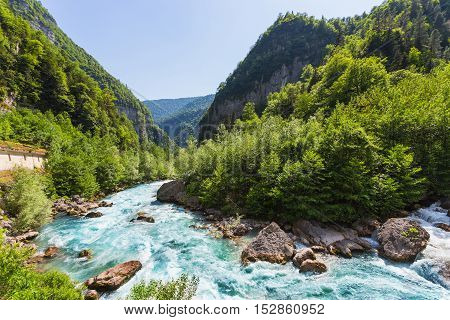 Landscape In Abkhazia With Caucasian Ridge And River