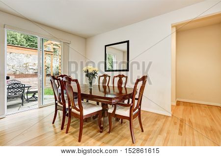 Light Dining Room With Wooden Carved Table And Chair Set