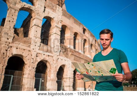 Young man in front of colosseum in rome, italy