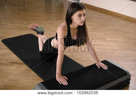Gorgeous And Strong Brunette Doing A Set Of Push Ups In A Gym