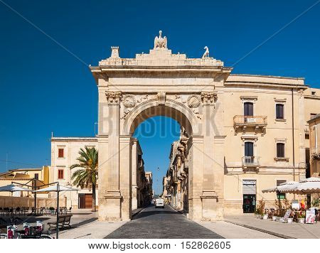 NOTO ITALY - SEPTEMBER 14 2015: Royal Gate or Arch of Porta Reale in Noto in Sicily Italy.