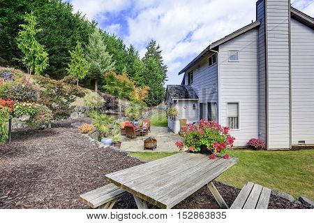 Gray Clapboard Siding House Backyard Area