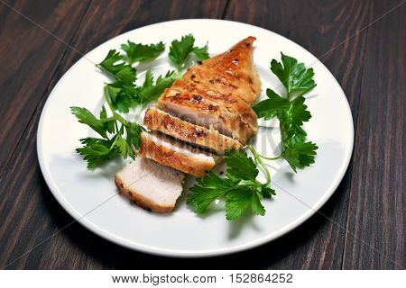 BBq, Roasted chicken breast on white plate