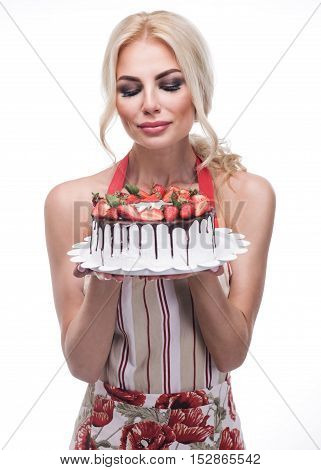 sexy woman eating a fruit cake isolated