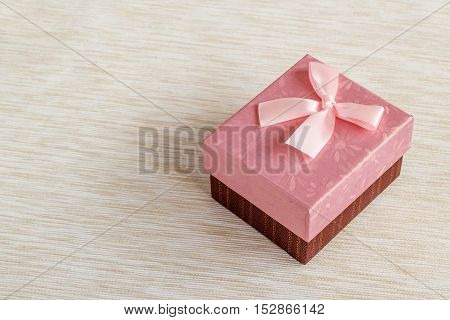 Romantic pink gift box with a ribbon background