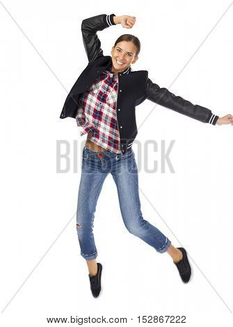 Flying concept. Full length portrait of a young brunette woman jumping over white background isolated