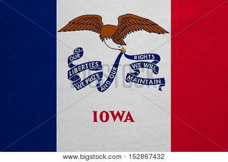 Flag of the US state of Iowa. American patriotic element. USA banner. United States of America symbol. Iowan official flag with real detailed fabric texture illustration. Accurate size colors