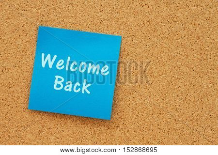 A welcome back message Bulletin board with a blue sticky note with text Welcome Back