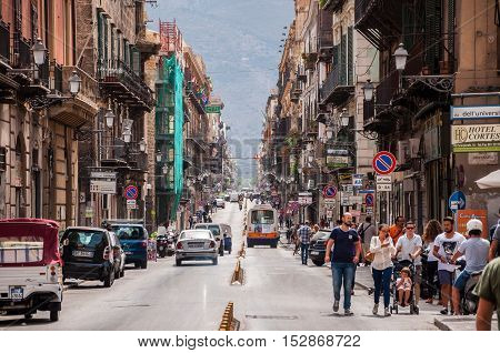 PALERMO ITALY - SEPTEMBER 7 2015: Pedestrians walking by via Maqueda famous street in old city centre of Palermo Sicily Italy.