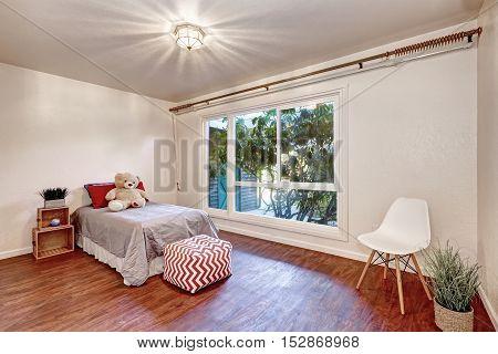 White Walls In Kid's Bedroom With Hardwood Floor