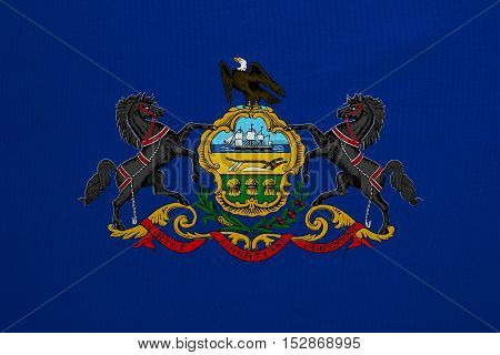 Flag of the US state of Pennsylvania. American patriotic element. USA banner. United States of America symbol. Pennsylvanian official flag detailed fabric texture illustration. Accurate size colors