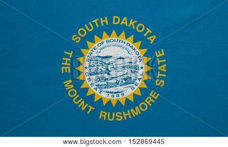 Flag of the US state of South Dakota. American patriotic element. USA banner. United States of America symbol. South Dakotan official flag detailed fabric texture illustration. Accurate size colors
