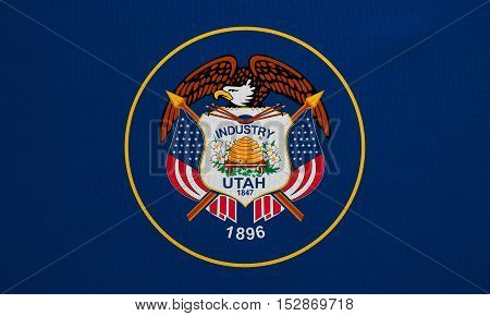Flag of the US state of Utah. American patriotic element. USA banner. United States of America symbol. Utahn official flag with real detailed fabric texture illustration. Accurate size colors