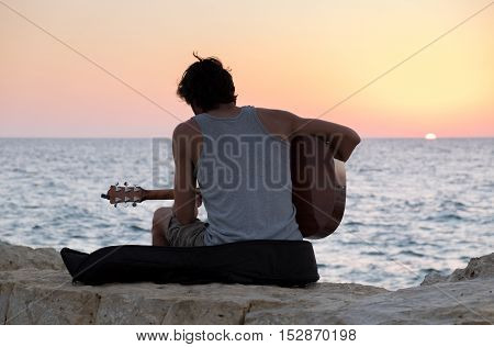 The Guitar Player On Tel-aviv Beach At Sunset