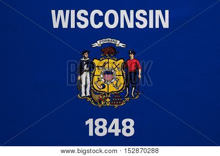 Flag of the US state of Wisconsin. American patriotic element. USA banner. United States of America symbol. Wisconsinite official flag real detailed fabric texture illustration. Accurate size color