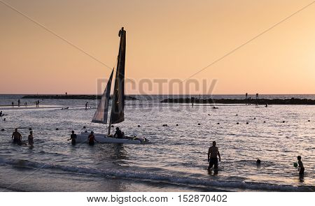 Catamaran In Mediterranean Sea At Sunset.tel-aviv. Israel