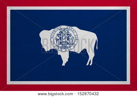 Flag of the US state of Wyoming. American patriotic element. USA banner. United States of America symbol. Wyomingite official flag with real detailed fabric texture illustration. Accurate size color