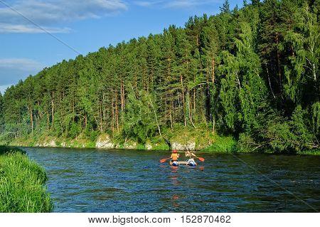 Beklenischevo, Russia - June 12, 2005: Water sportsmen move on Iset river
