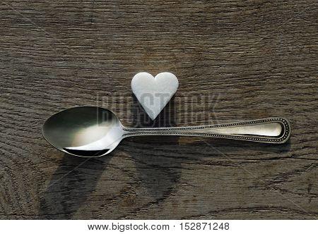 White sugar heart with a tea spoon