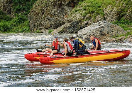 Beklenischevo, Russia - June 12, 2005: Water tourists move on rapid river