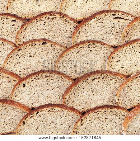 Bread from rye flour background, top view