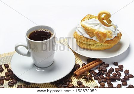 Cup of coffee cake in the form of a swan and coffee beans
