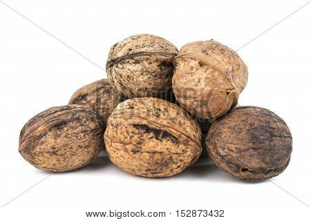 Some walnuts isolated on white background with shadows