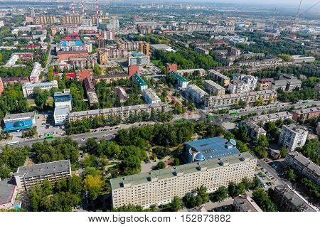 Tyumen, Russia - August 18, 2016: Aerial view on sleeping neighborhood large-panel houses with TV tower, so called KPD. Respubliki and Tulskaya streets intersection
