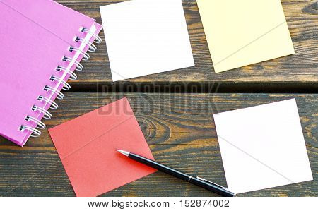 empty paper and notebook on the old wooden table