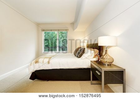 Neat Bedroom With A Bed And Nightstands With Lamps